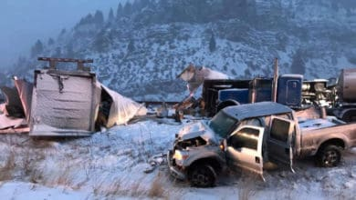 Tractor-trailer wreck on snowy Colorado highway.