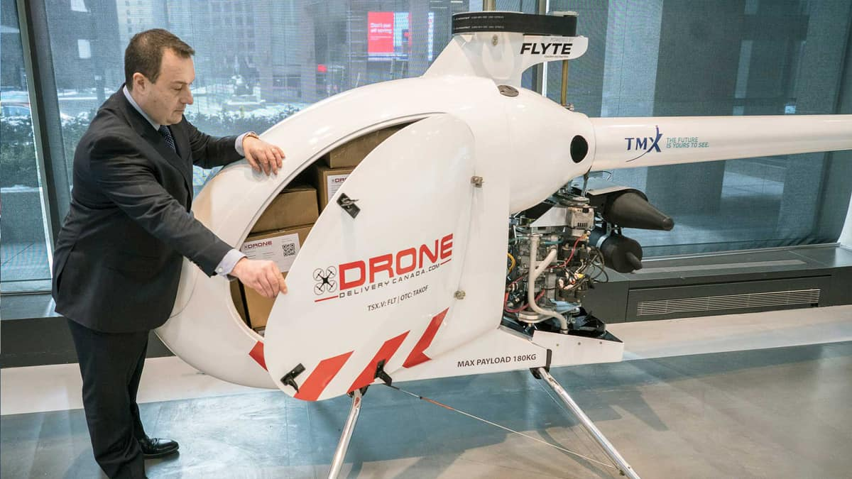 A small drone shaped like a helicopter for package deliveries.