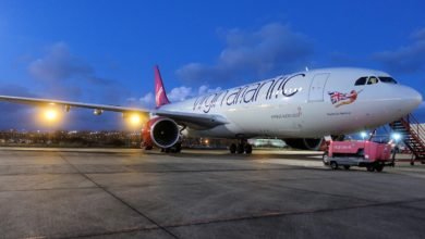 Virgin Atlantic plane on tarmac at night