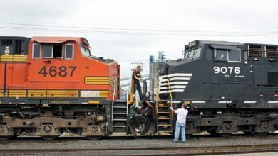 A photograph of two train locomotives.