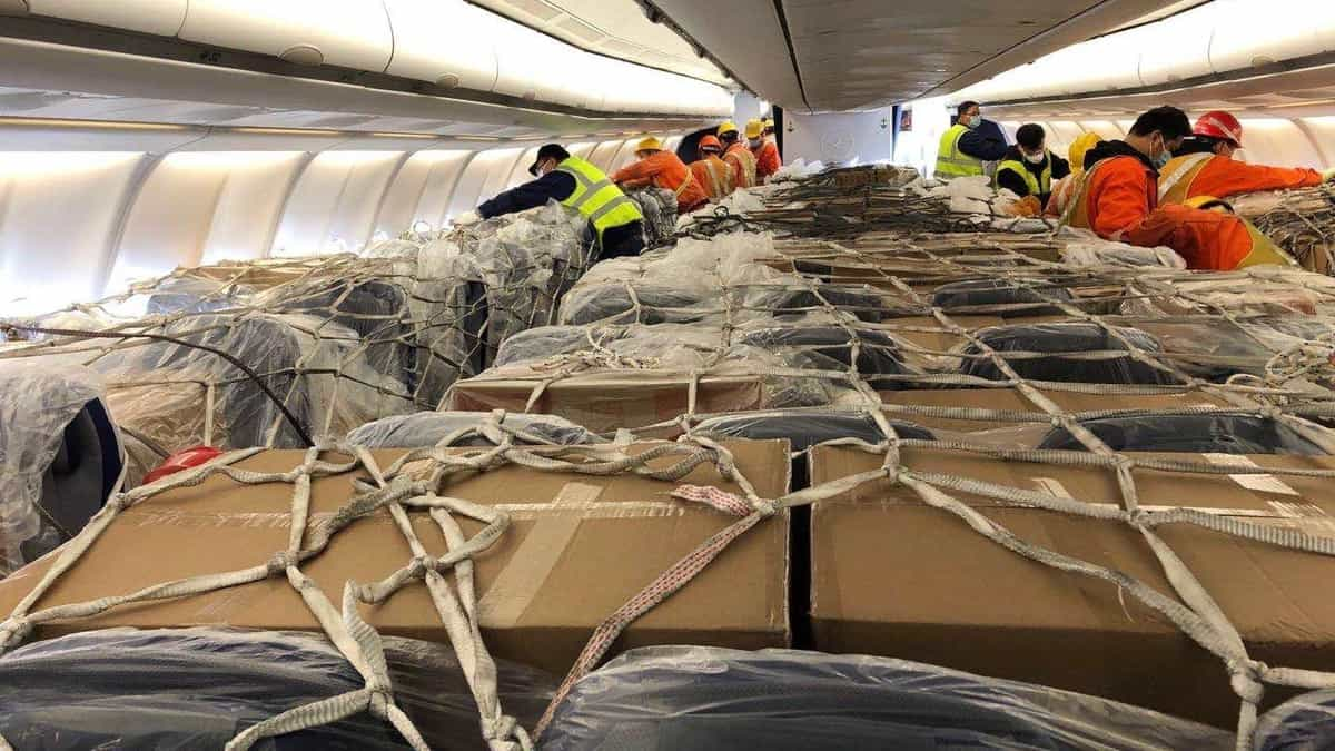 Workers put cargo in airplane seats