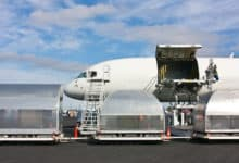 Air freighter and cargo pallets on tarmac