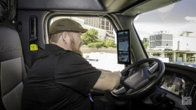 Truck driver using camera monitoring system to assist driving