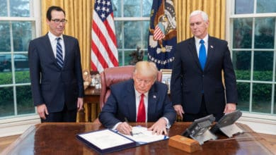 Photo of Trump signs bill to require many employers to provide paid leave
