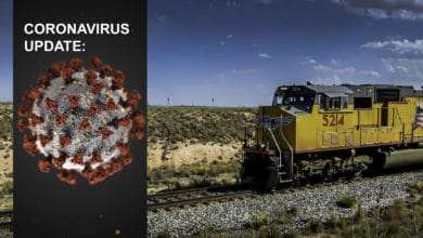 "A composite image. On the left are the words ""coronavirus update,"" with a close-up image of the virus strain. On the right is a photograph of a train."