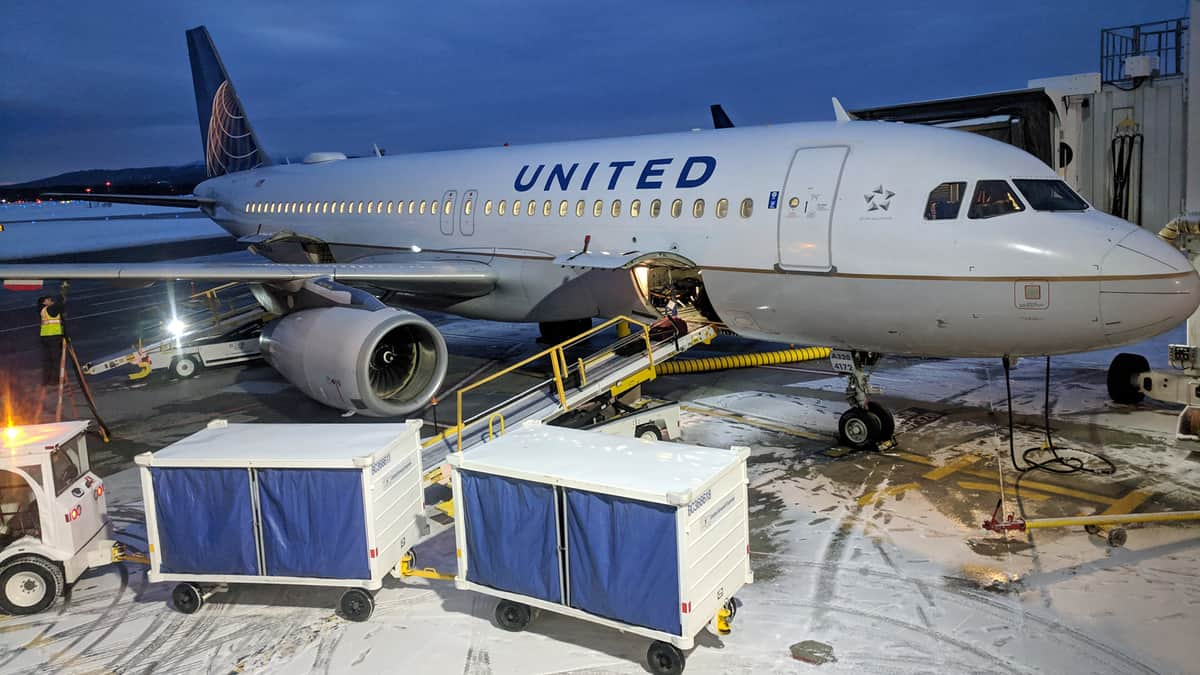 United Airlines plane gets loaded with baggage.