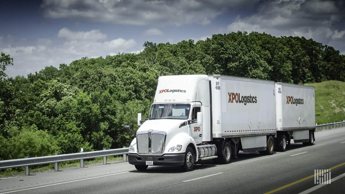 XPO LTL tractor and two pup trailers on road