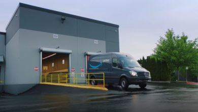 Amazon delivery van leaving fulfillment center
