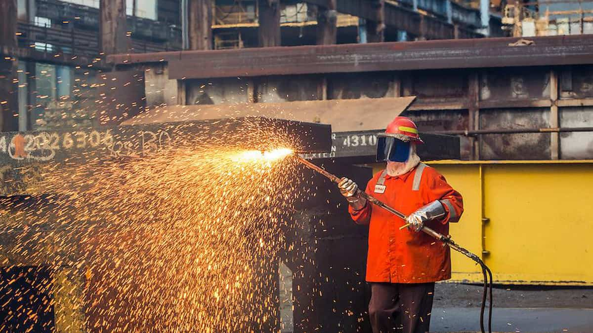 A worker at the EVRAZ steel plant in Regina, Canada