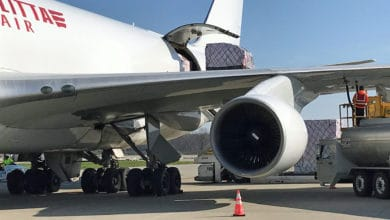 Close up of a white cargo plane being loaded.