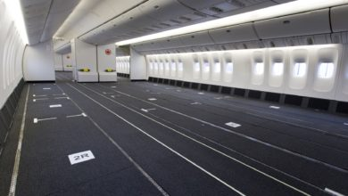 Passenger cabin of plane with seats removed for cargo.