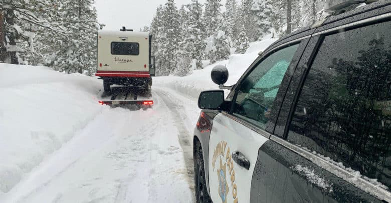 Highway patrol truck on snow California road.