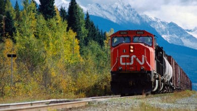 A photograph of a train. There is a mountain behind the train.