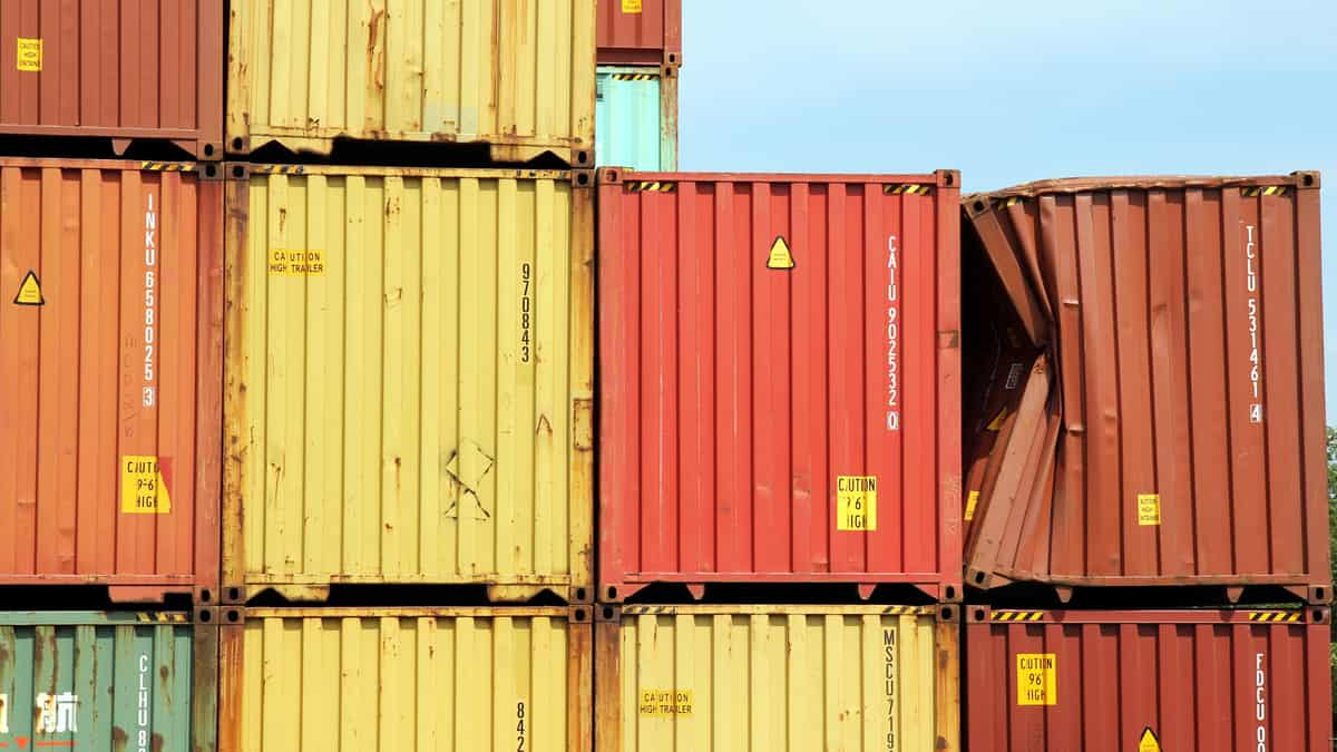 Several stacked containers; one is severely dented.