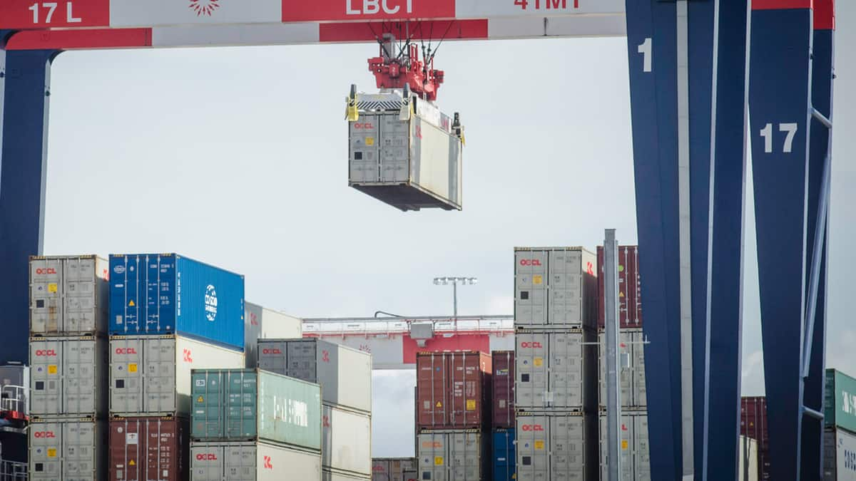 A container being moved by a crane.