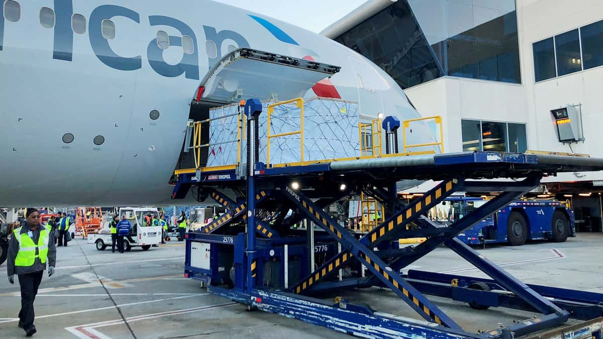 Cargo being loaded onto an American Airlines airplane.
