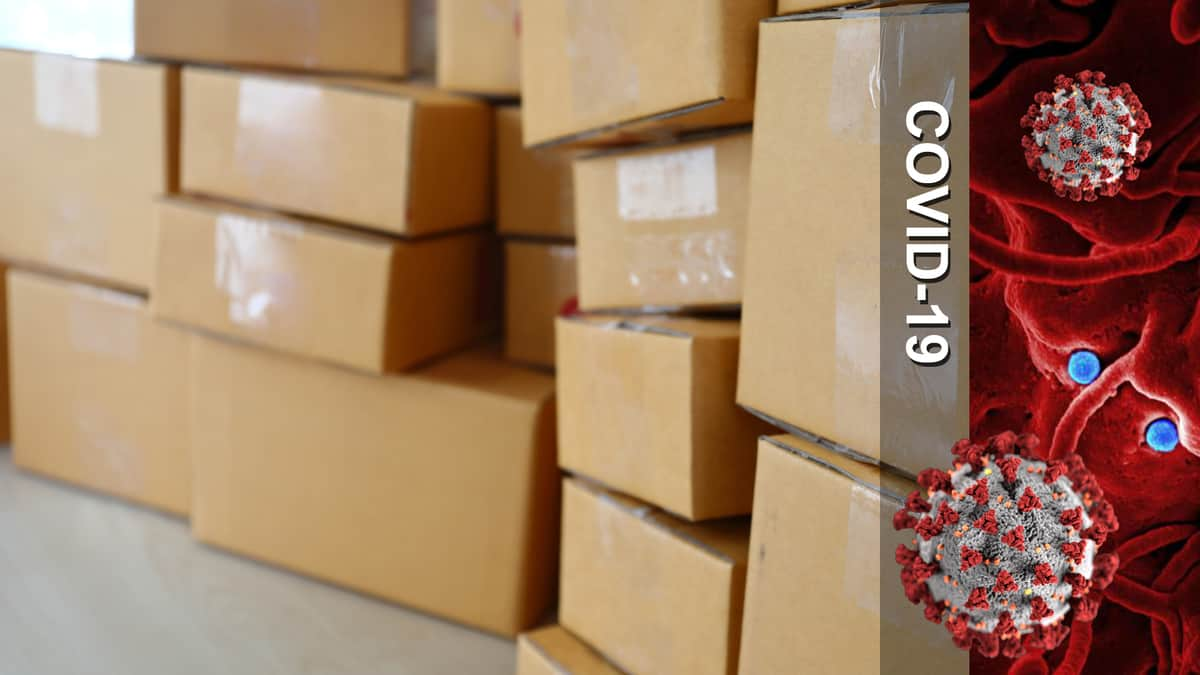 Boxes piled on top of each other + COVID-19 image.