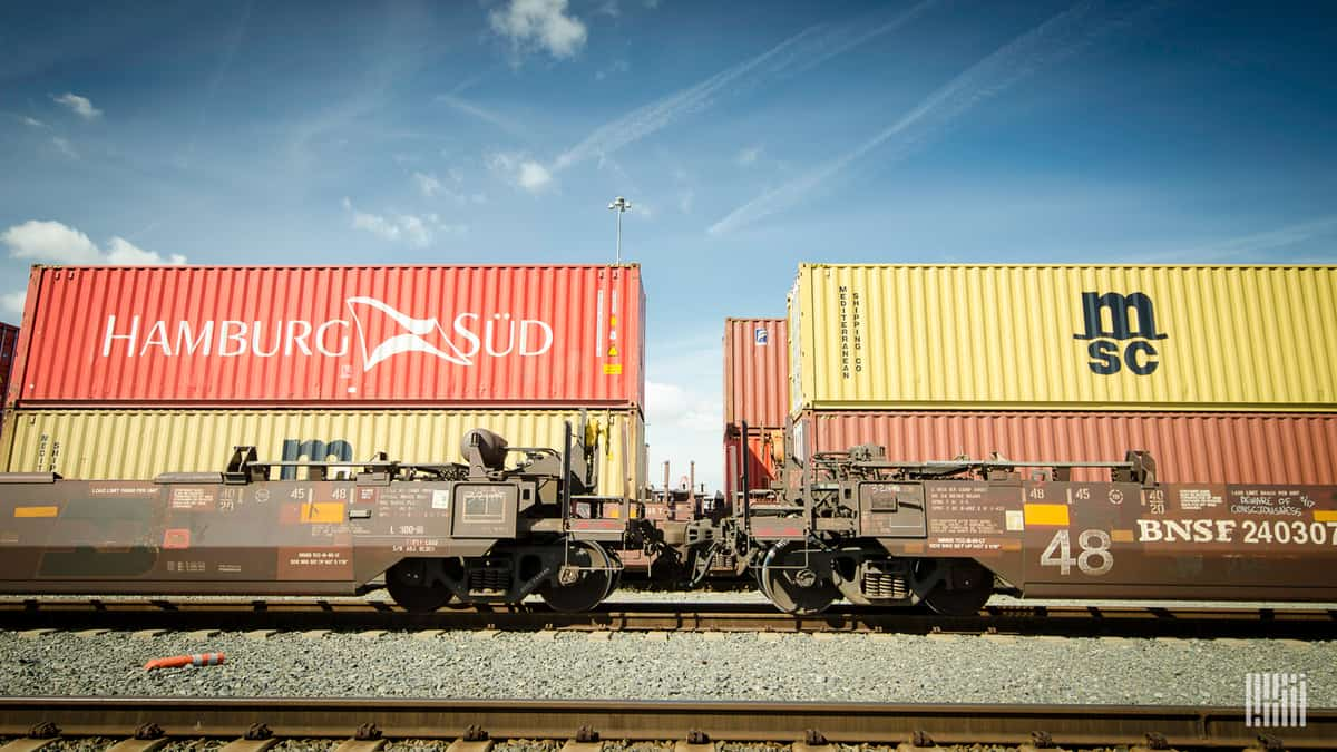 A photograph of intermodal containers at a rail yard.