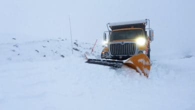 Plow clearing snowy Montana highway.