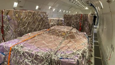 Pallets of freight inside a giant cargo plane.