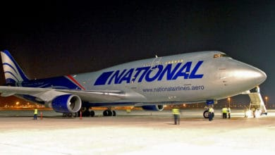 Big jumbo jet freighter on tarmac at night.