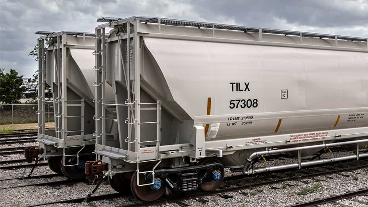 A photograph of two hopper cars for the railroad.