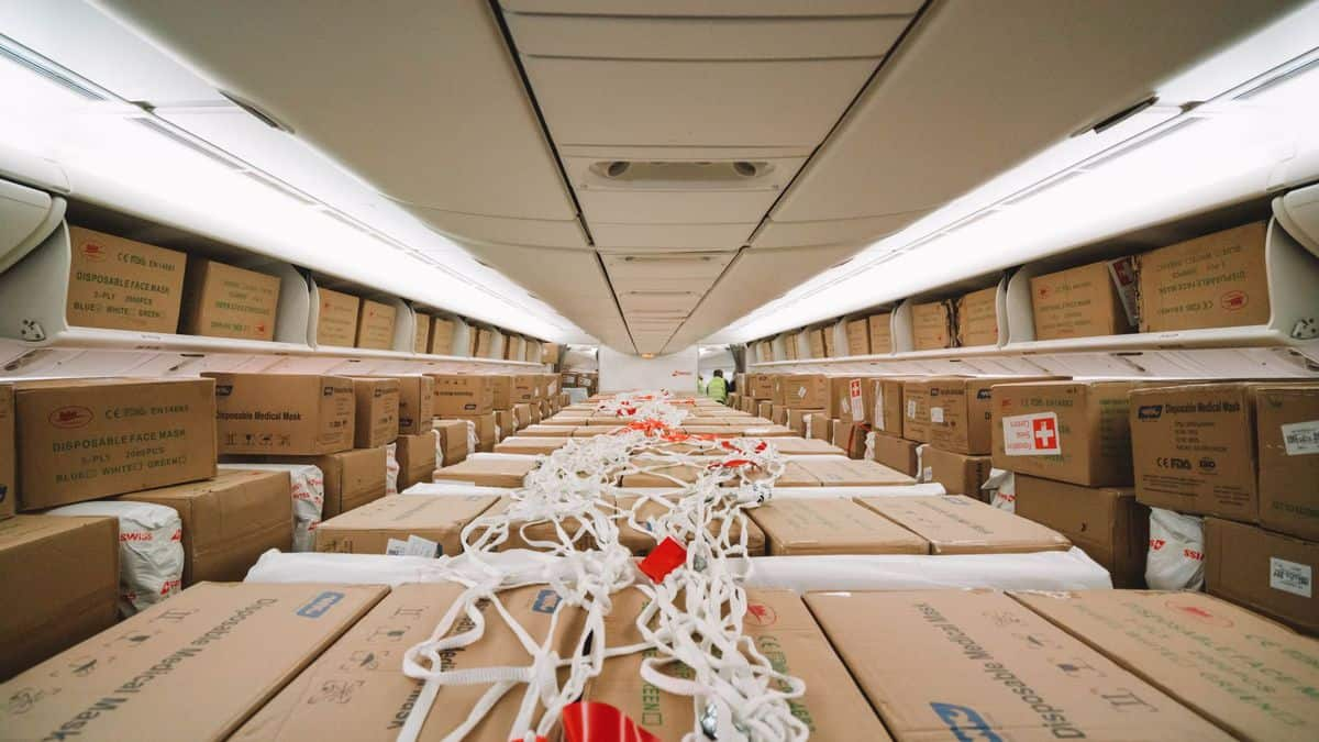 Lots of boxes, instead of people, fill the passenger cabin of plane.