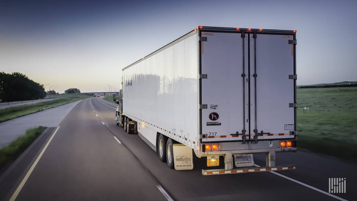 Unidentified trailer moving down highway