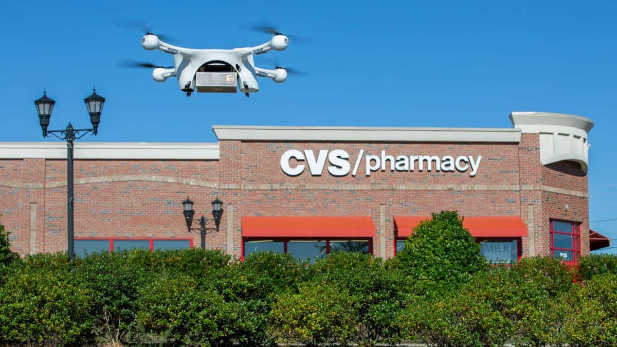 A drone takes off outside a CVS store to make a delivery.