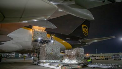UPS plane gets unloaded at night.