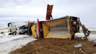 Overturned tractor-trailer on snowy Wyoming highway.on