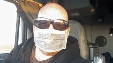 Canadian truck driver Randy James Ulch wearing a face mask in his cab