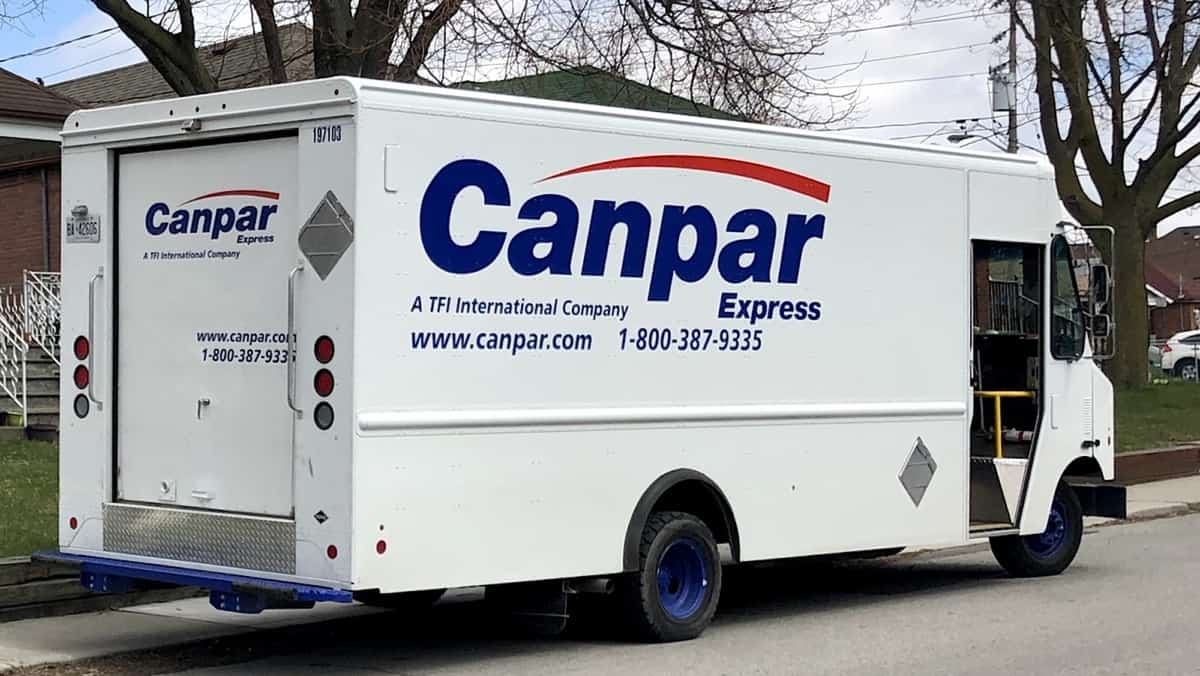 A van from TFI's Canpar stops for a delivery in Toronto, Canada,