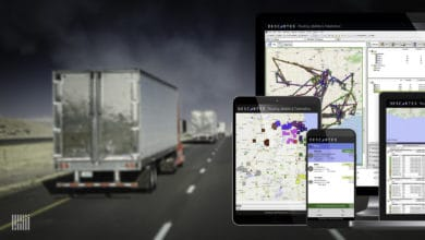 A tractor-trailer and screens of Descartes Systems Group screens.
