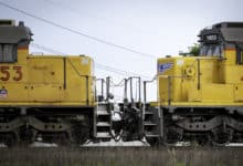 A photograph of two railcars.