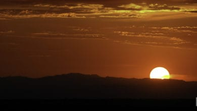 Sun just above the horizon of the Southwest desert sky.