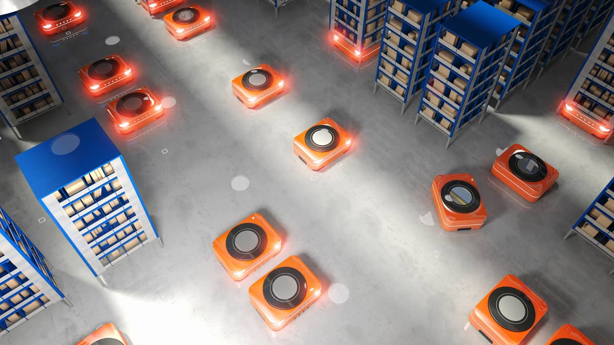 Robots move around in a warehouse space.