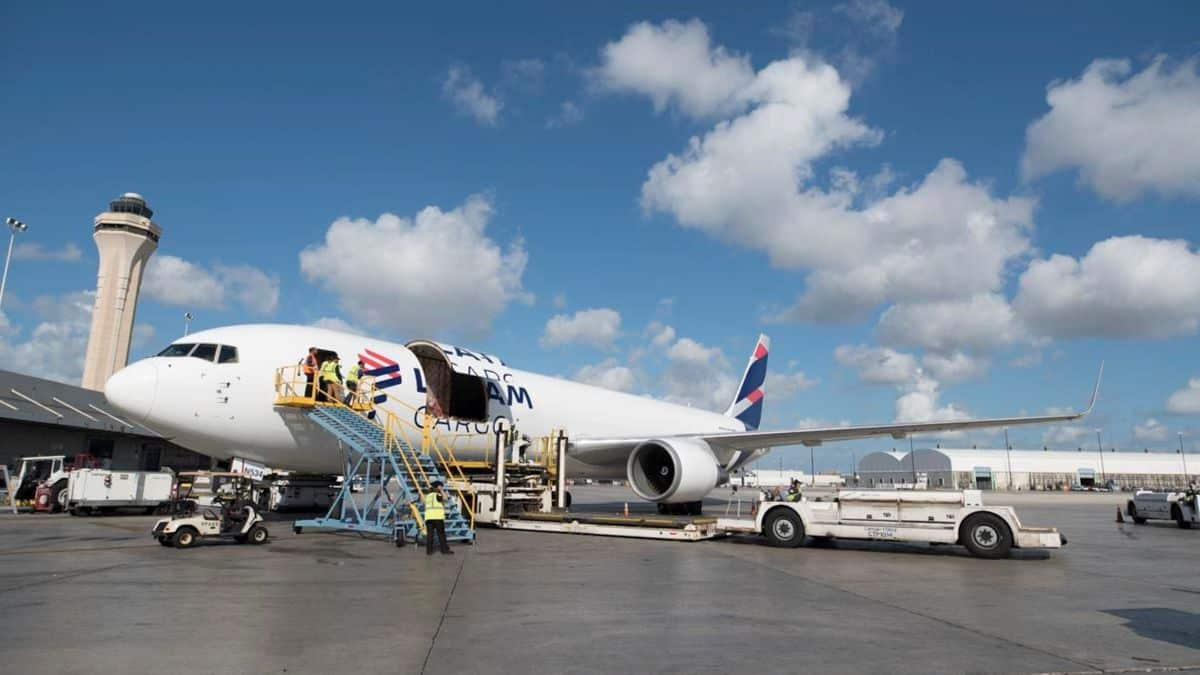 Cargo being unloaded from a large white cargo jet.
