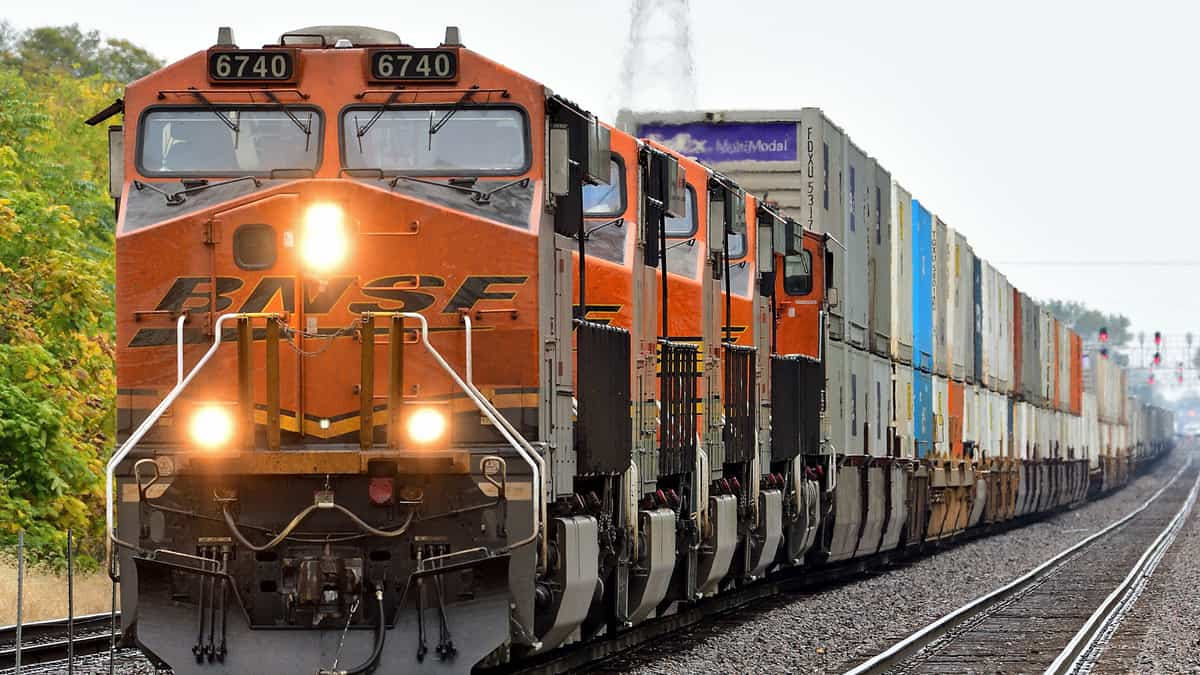 A photograph of a train locomotive pulling intermodal containers.
