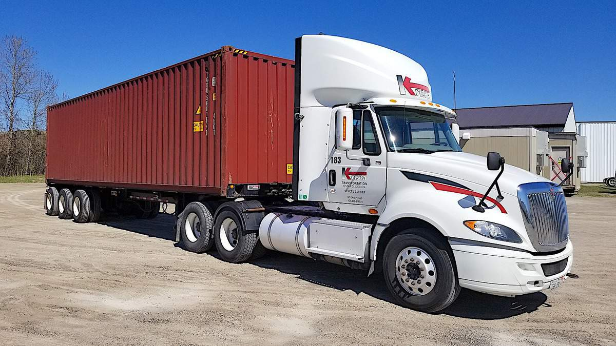 A Kriska tractor hauling an intermodal container.