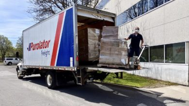 A Purloator driver making a less-than-truckload delivery