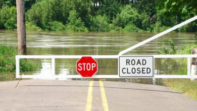 "Flooded road with ""Road Closed"" sign."