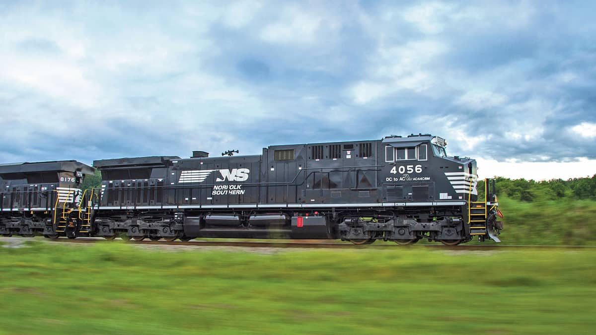 A train led by two Norfolk Southern engines.