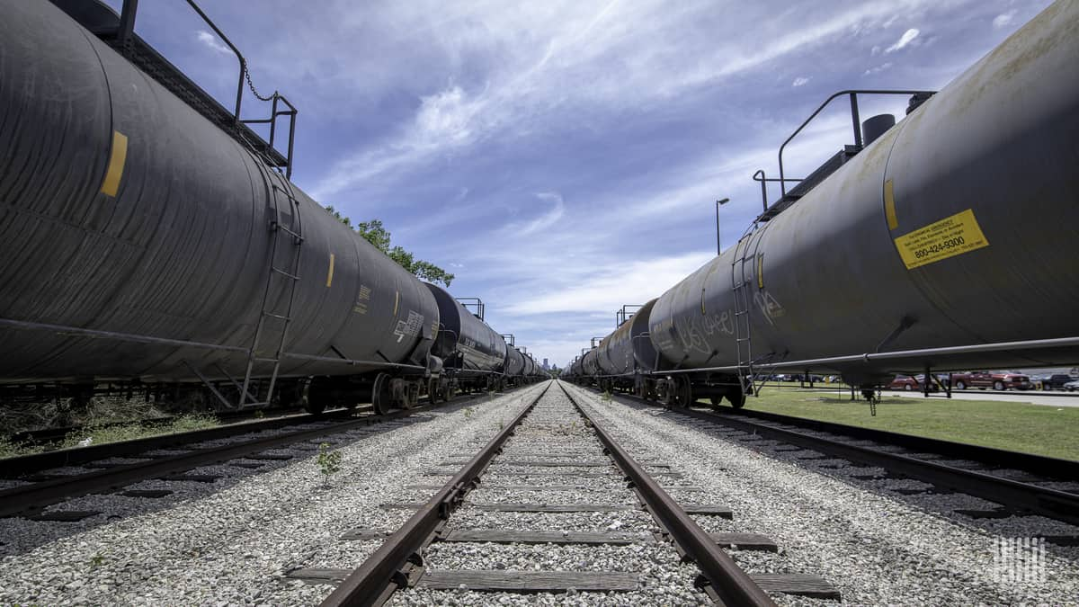 Tank cars sit on two of three tracks visible in this photo