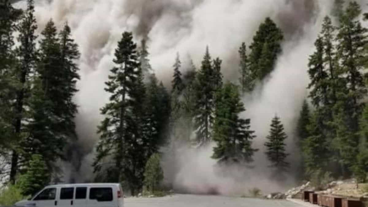 Dust clouds roll down California mountainside during June 24 earthquake.