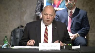 Large bald man, the head of the FAA, speaks before congressional committee.