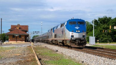 A photograph of a train leaving a train station.