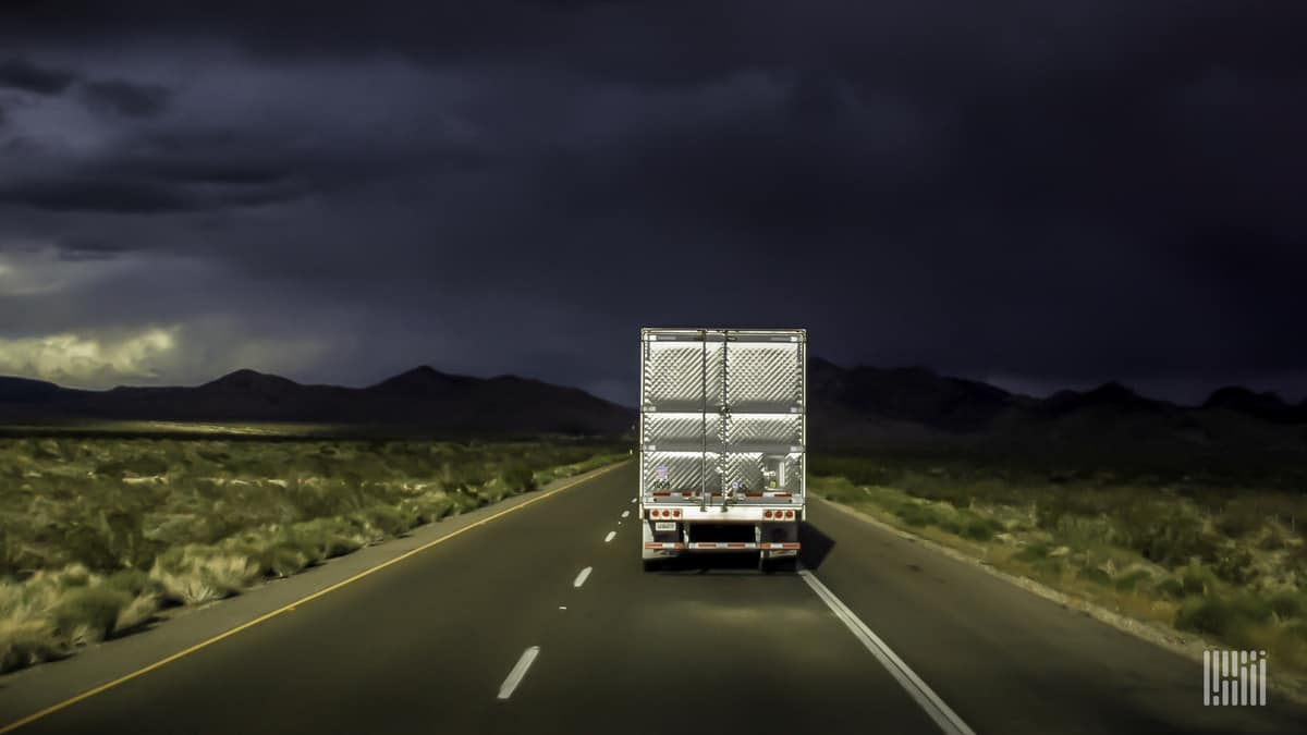 truck traveling down highway
