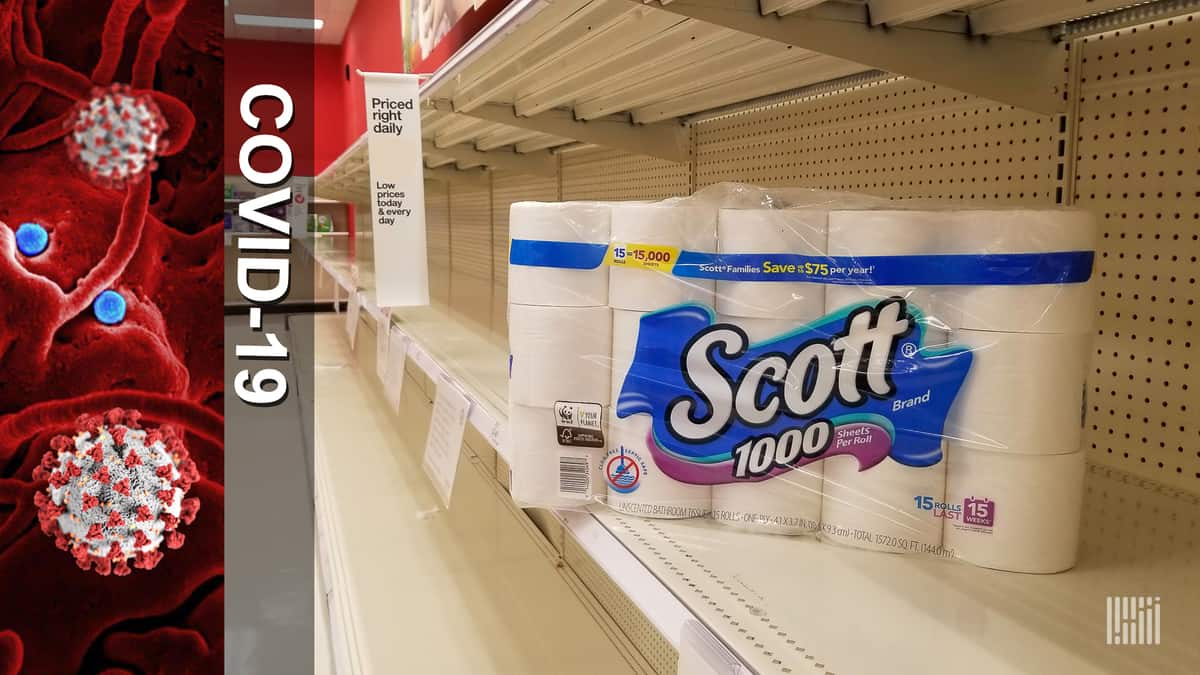a pack of toilet paper on an otherwise empty store shelf
