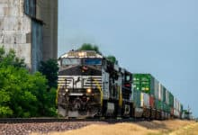 A photograph of a train hauling intermodal contrainers.